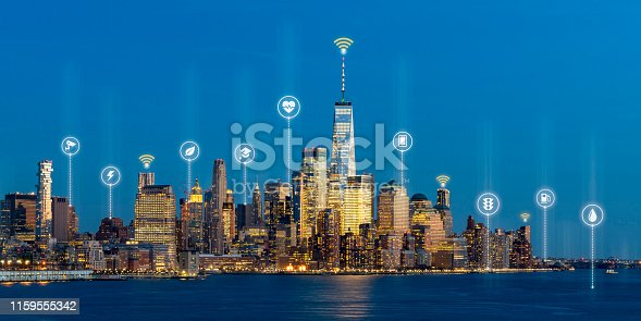 istock Beautiful scenic night view of new york, manhattan, usa in smart city service icon, internet of things, network technology concept. Smart city in urban downtown connected realtime sensor with people. 1159555342