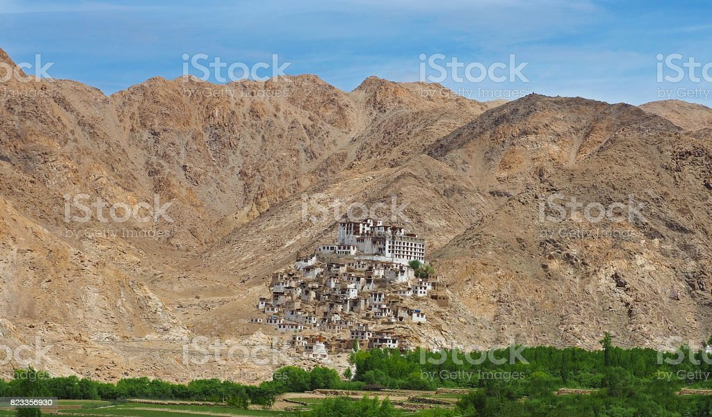 Beautiful scenic view - ancient Chemrey Buddhist Monastery (Gompa) against the background of  mountain wall on the way to Pangong Lake road, Ladakh, Himalaya, Jammu & Kashmir, India stock photo