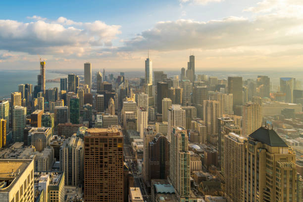 Beautiful scenic view of business district of Chicago loop with skyline in evening sunlight. Panoramic view aerial top view or drone architecture view of city. Famous attraction in Chicago, USA. stock photo