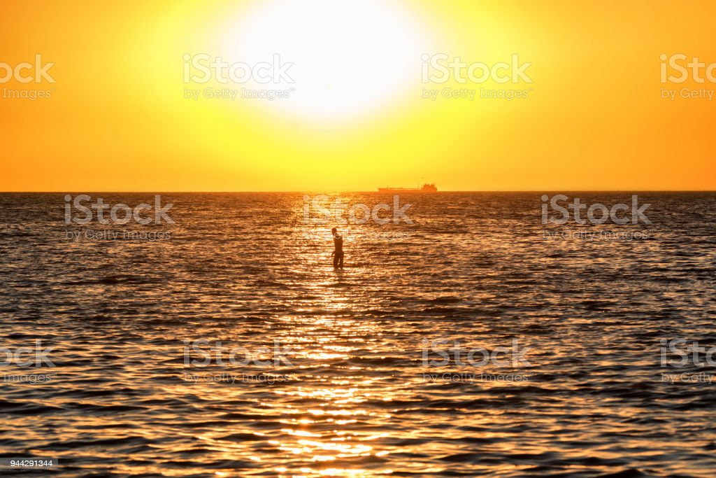 Beautiful sea landscape of man in Sea of Azov stock photo