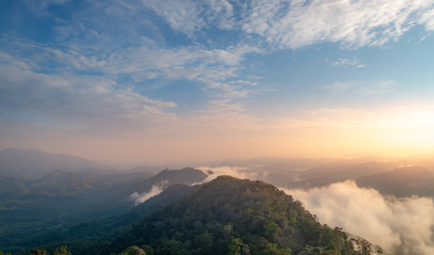 Beautiful sea of mist at mountain peak in Betong , Yala , sounthern of Thailand Beautiful sea of mist at mountain peak in Betong , Yala , sounthern of Thailand yala stock pictures, royalty-free photos & images
