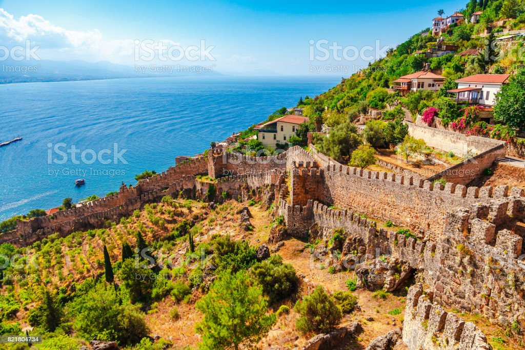 Beautiful sea panorama landscape of Alanya Castle in Antalya district, Turkey, Asia. Famous tourist destination with high mountains. Summer bright day and sea shore stock photo