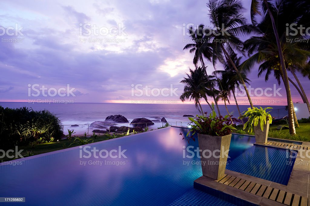 Beautiful sea side villa against a cloudy sunset royalty-free stock photo