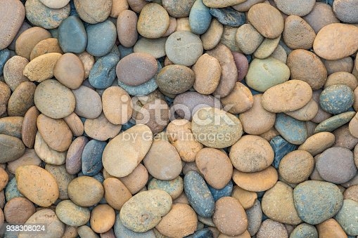 istock beautiful sea stone background. 938308024