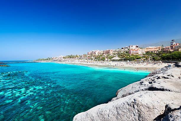 de l'eau de mer tropical de plage el duque - canari photos et images de collection