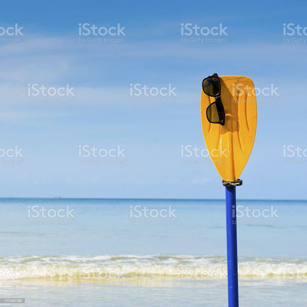 Beautiful sea with sunglass and kayak blade royalty-free stock photo