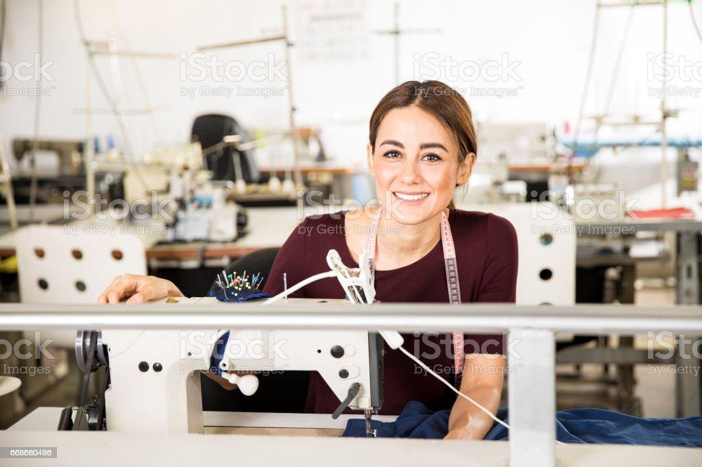 Beautiful seamstress enjoying her job stock photo