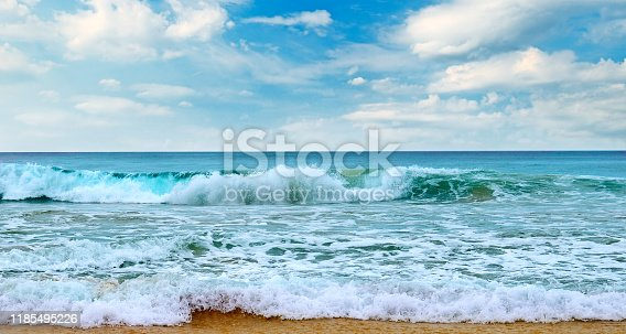 Beautiful seascape and blue sky. Sand beach. The concept is travel. Wide photo.