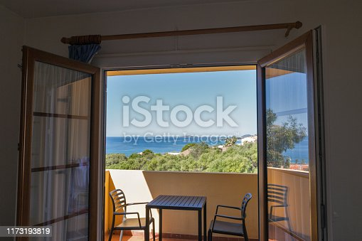 Beautiful seascape from balcony room with wide open window in Ajaccio, Corsica island, France. West coast overlooking the archipelago of the Sanguinaires.