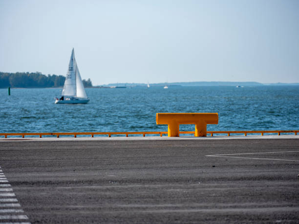 A beautiful seascape of Finnish archipelago shot from commercial port towards the sea. A large yellow bollard in the foreground. stock photo