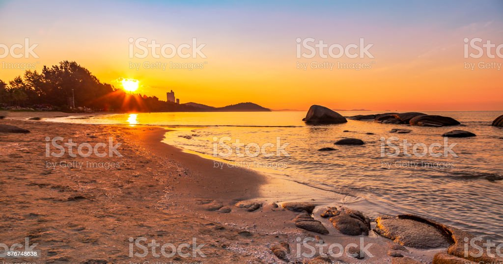 Beautiful seascape of Mae Pim beach during sunrise in Rayong province of Thailand. stock photo