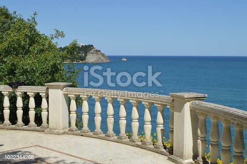 Beautiful seascape, view from white stone balustrade on Sunny summer day.