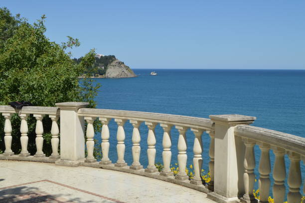 Beautiful seascape, view from white stone balustrade on Sunny summer day stock photo