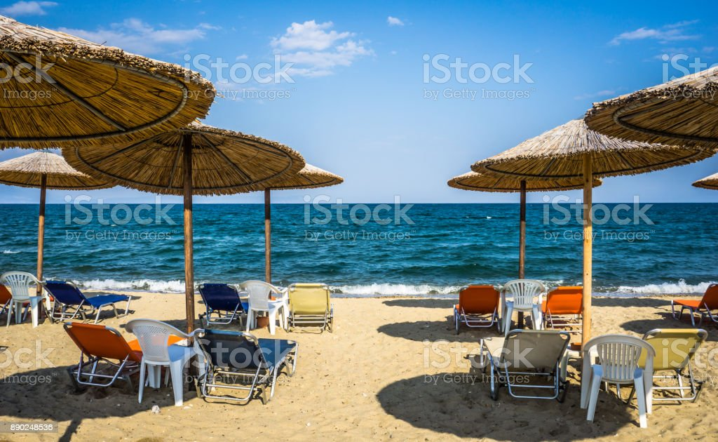 Beautiful Seascape With Beach Umbrellas And Sunbeds, Stavros, Greece stock photo