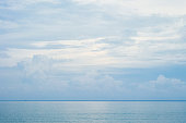 The beauty in nature, beautiful seascape with sea horizon against the light blue sky before sunset.