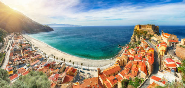 Beautiful seaside town village Scilla with old medieval castle on rock Castello Ruffo stock photo
