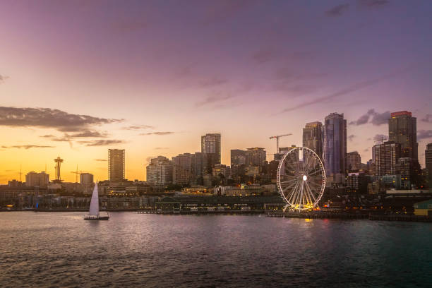 Beautiful Seattle waterfront skyline from Elliott Bay at dusk. Dreamy cityscape or scenery. Washington state, USA. Beautiful Seattle waterfront skyline from Elliott Bay at dusk. Dreamy cityscape or scenery. Washington state, USA. puget sound stock pictures, royalty-free photos & images