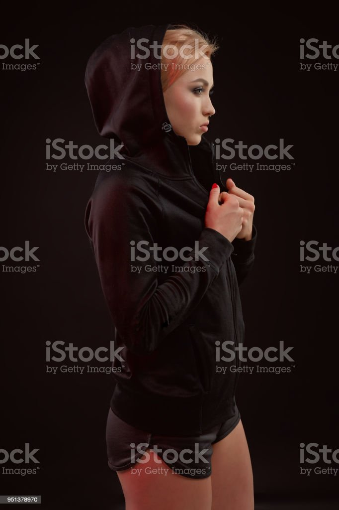 76d4b6551 Beautiful seductive sporty girl with the slim sexy figure in the black  hoodie