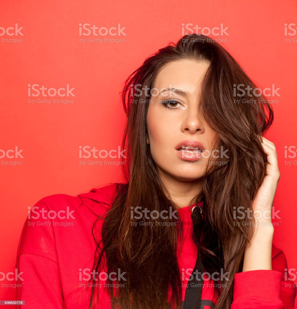 Beautiful Seductive Woman In A Red Blouse On Red Background Stock ...