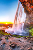 Beautiful  Seljalandsfoss waterfall in Iceland during the sunset. Location: Seljalandsfoss waterfall, part of the river Seljalandsa, Iceland, Europe