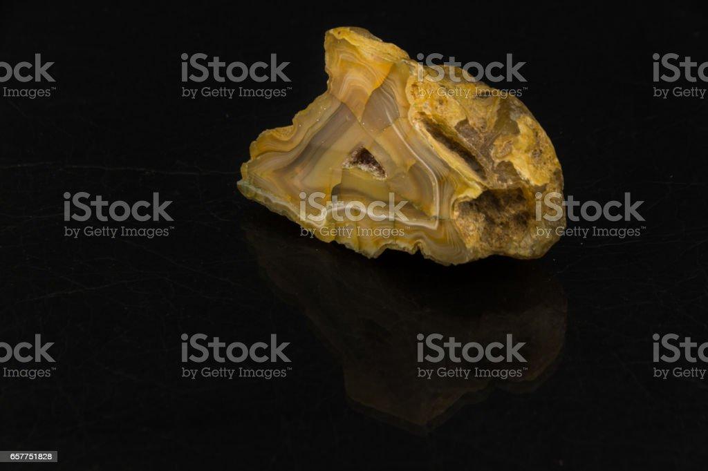 Beautiful semi-precious stone Agate cut  on a black background stock photo