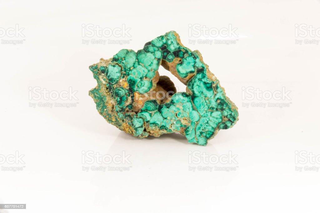Beautiful semiprecious stone green malachite  on a white background stock photo