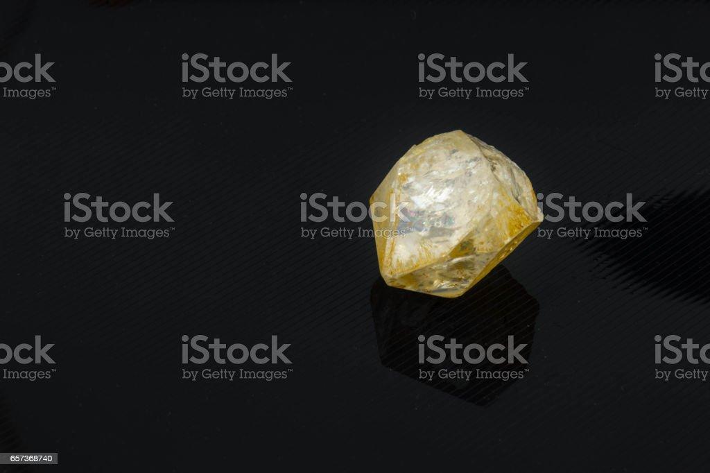 Beautiful semi-precious stone Quarz crystal on a black background stock photo