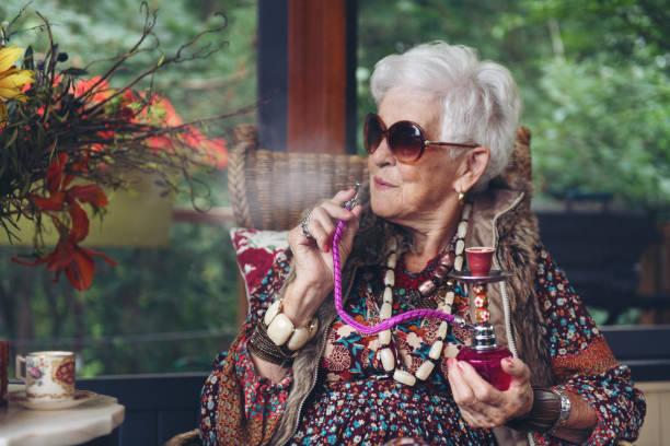 Beautiful senior boho stylish woman stock photo