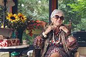 Beautiful senior boho stylish woman, 84 years old