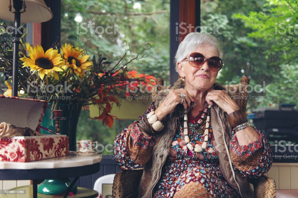 Beautiful senior boho stylish woman stock photo
