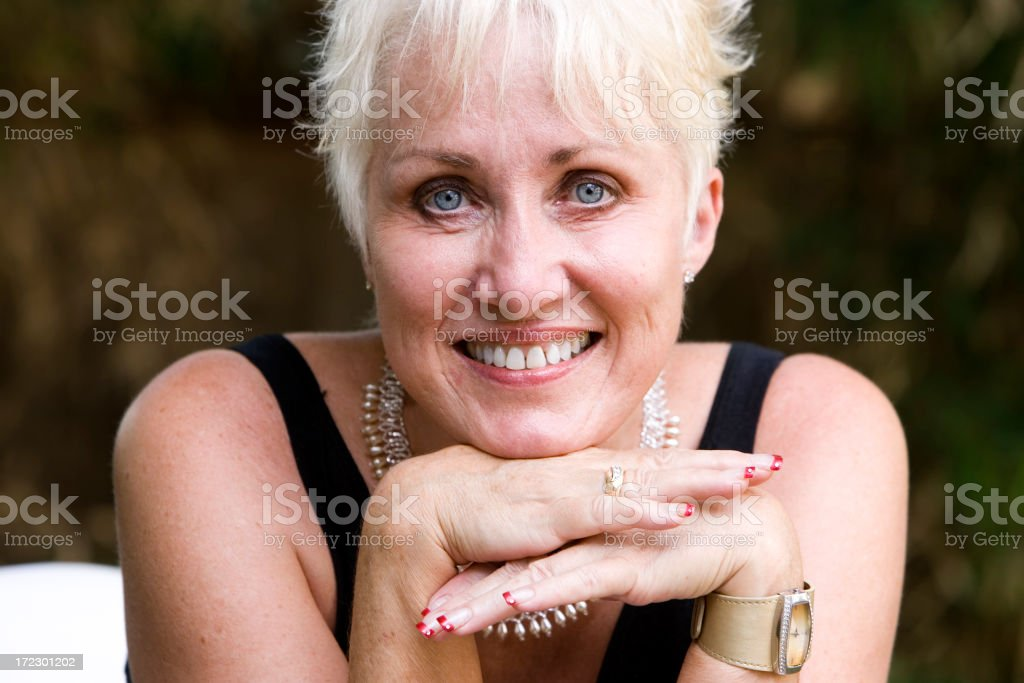 Beautiful Senior Citizen Woman Portrait Outdoors, Smiling at Camera royalty-free stock photo