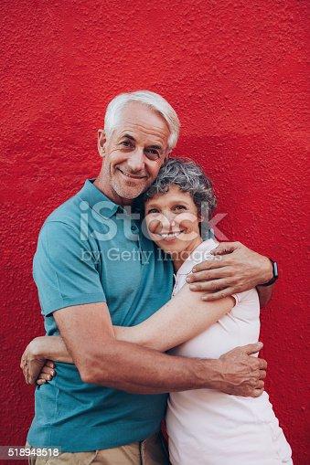 istock Beautiful senior couple embracing 518948518