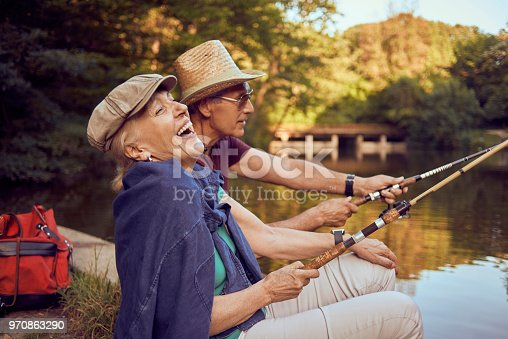 active senior couple enjoying retirement in nature