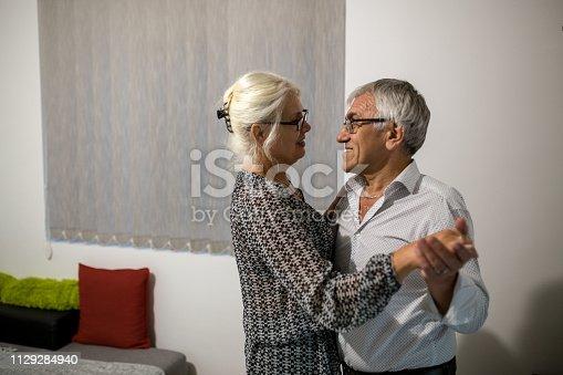 Beautiful senior couple in love dancing.