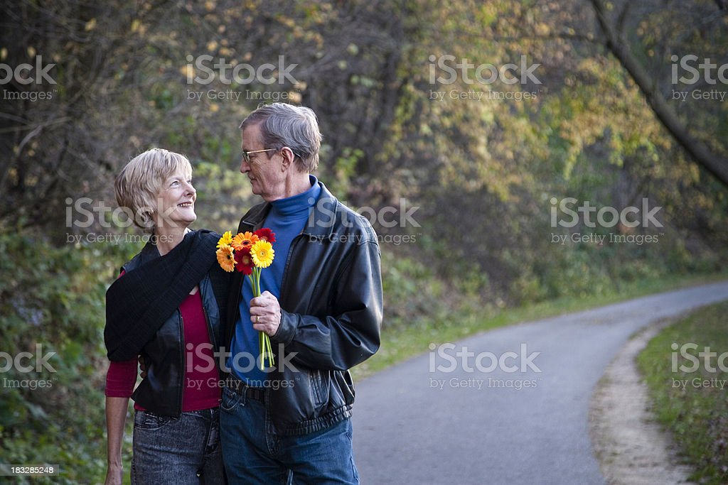 Beautiful Senior Couple Outside on a Walk royalty-free stock photo