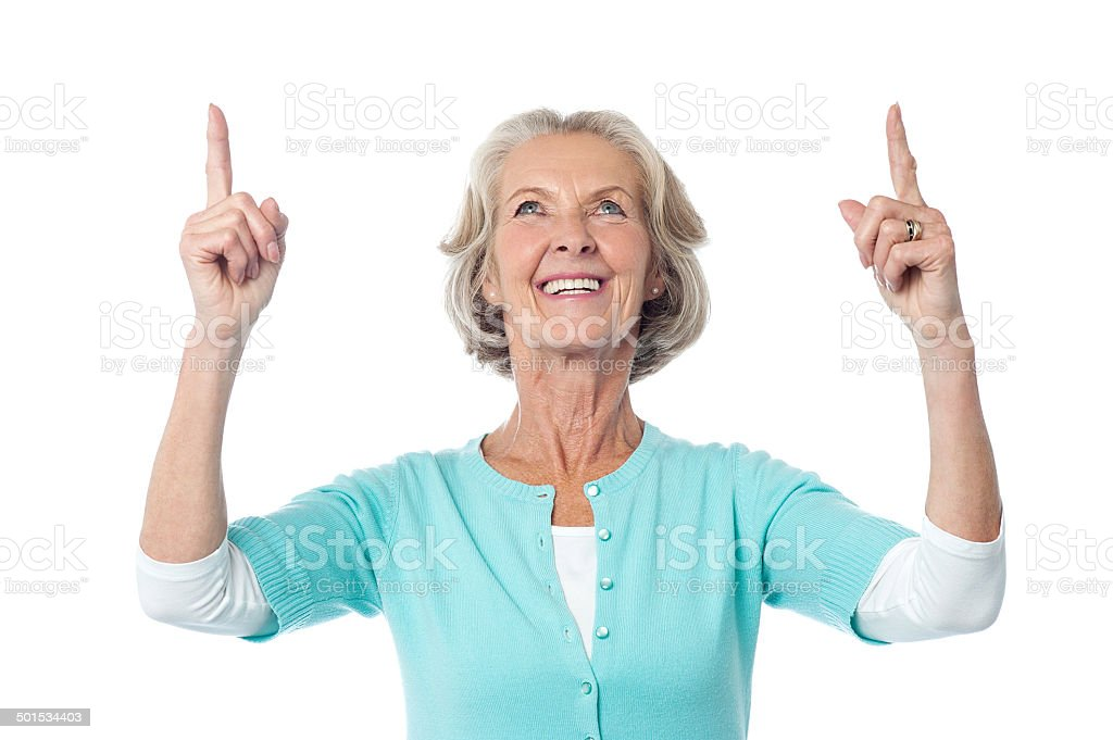 Beautiful senior lady pointing upwards - Royalty-free Active Seniors Stock Photo