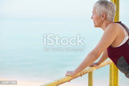istock Beautiful senior woman exercise 528617360