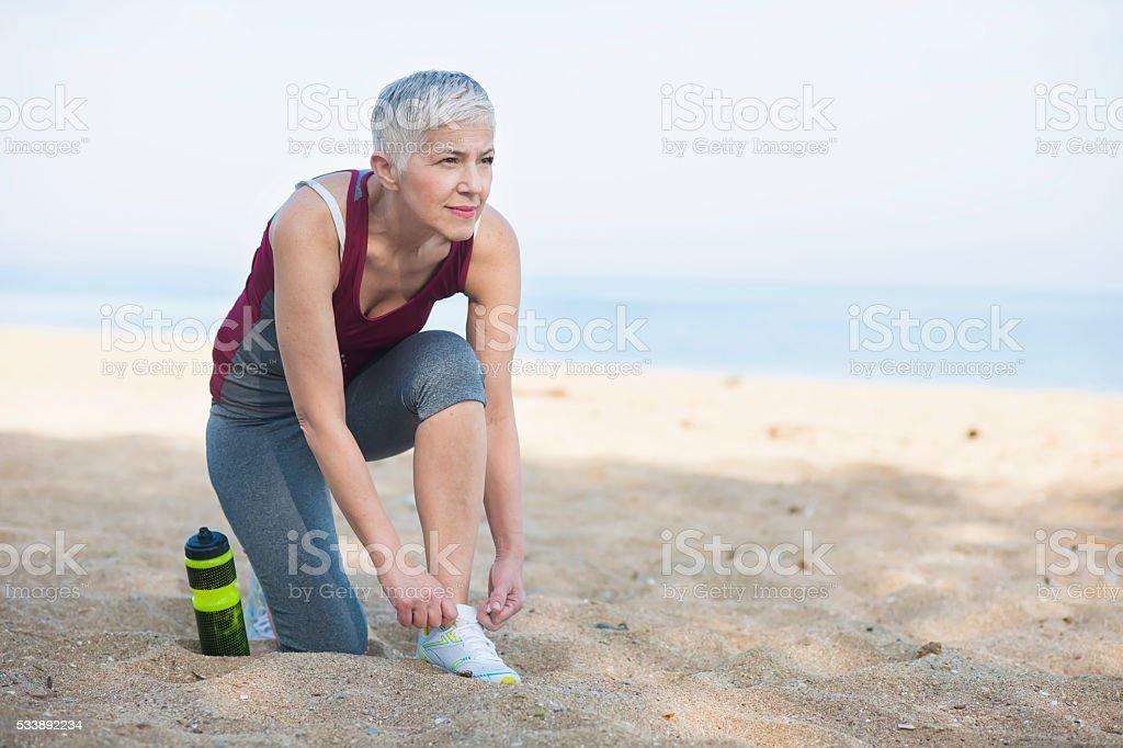 Beautiful senior woman exercise stock photo