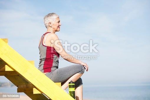 istock Beautiful senior woman exercise 597659696