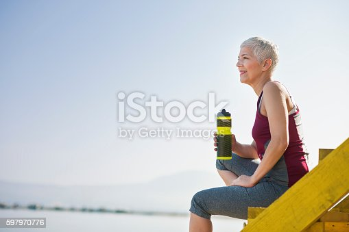 istock Beautiful senior woman exercise 597970776