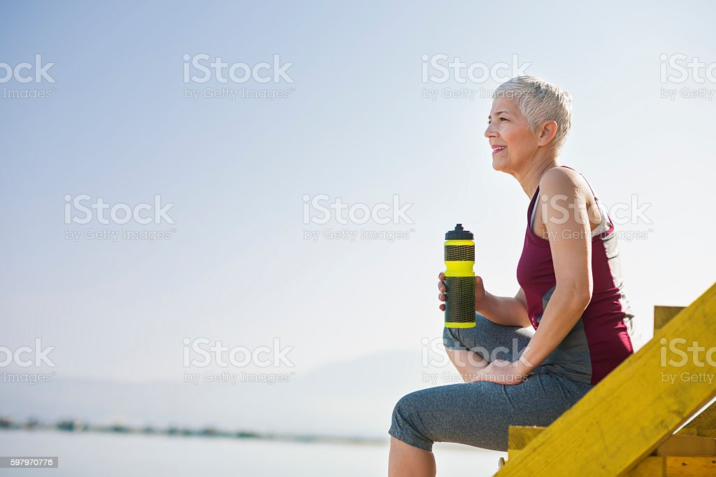 Beautiful senior woman exercise stock photo