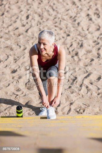 istock Beautiful senior woman exercise 597970928
