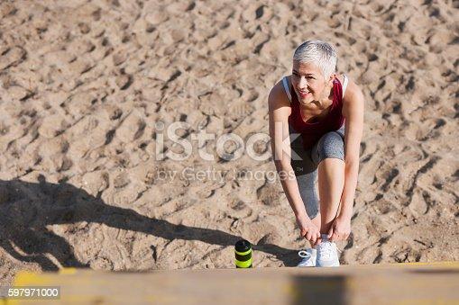istock Beautiful senior woman exercise 597971000