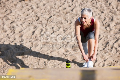 istock Beautiful senior woman exercise 597971066