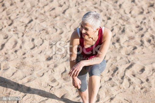 istock Beautiful senior woman exercise 597971140