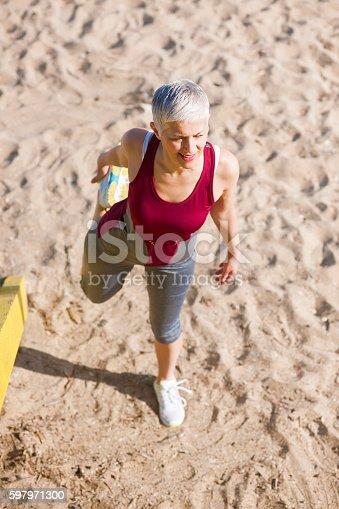 istock Beautiful senior woman exercise 597971300