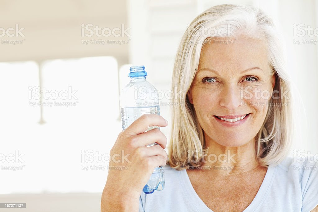 Beautiful Senior Woman Holding Water Bottle royalty-free stock photo