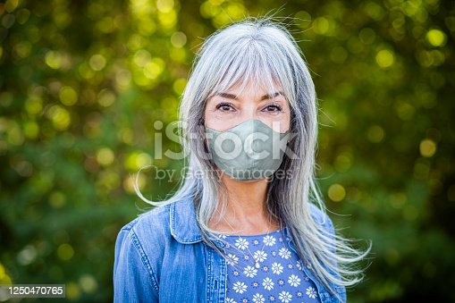 A portrait of a beautiful senior woman outdoors