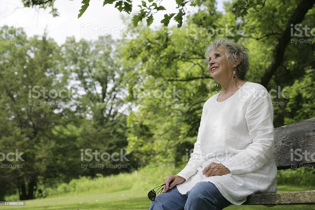 Beautiful Senior Woman Outside in Nature Looking Happy and Carefree royalty-free stock photo