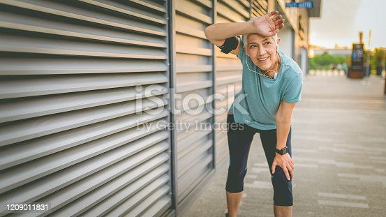 1057638814 istock photo Beautiful senior woman resting after work out outdoor. 1209011831